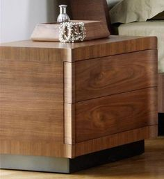 Curved multi-layered and solid wood chest of two drawers in walnut