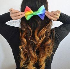 Ombré curly hair with rainbow bow