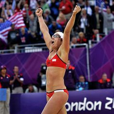 Team U.S.A.'s beach volleyball star Misty May-Treanor throws her hands up in celebration Tuesday after defeating China in an Olympics semi-final match in London. The athlete and teammante Kerri Walsh Jennings will head to an all-American gold medal match against April Ross and Jennifer Kessy.  http://www.people.com/people/gallery/0,,20618991,00.html#