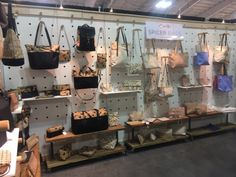Trade Show Booth:  Our gals at Spicer Bags making us look good!  Love this peg board look and modular construction.