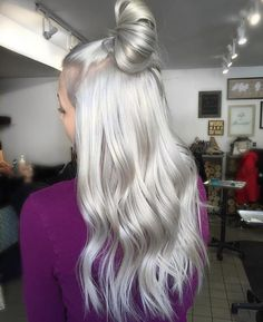 She's a silver fox. Silky top knot via @josievilay