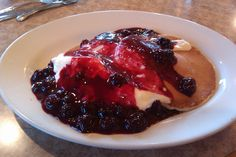 Boysenberry and cream cheese pancakes from the Gourmet Cafe and Pie Company in Los Alamitos, CA - of course with a cold glass of milk.
