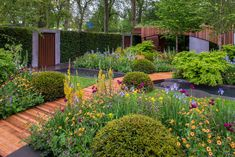 The Homebase Garden at the RHS Chelsea Flower Show 2015 / RHS Gardening. The garden is inspired by the work of modernist architect Marcel Breuer and the balance of nature and the man-made environment. The garden is intended to sit comfortably in the urban environment and form a place for a small inner-city community to come together.