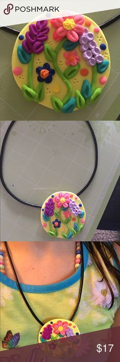 🌼💐Flower Pendant🌼💐 Handmade polymeric clay pendant brown base with colorful flowers. Just the pendant for sale, leather necklace NOT included. Handmade Jewelry Necklaces
