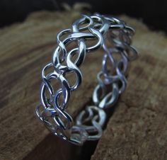 Celtic Woven Argentium Ring ( Etsy:: http://www.etsy.com/listing/68478643/celtic-woven-argentium-sterling-silver )