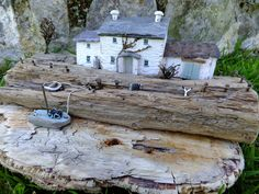Lobster Pot Cottage by Trysorau Cymraeg.  Handmade from Driftwood and reclaimed materials.
