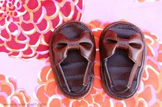 "Sandals tutorial - These are just adorable.  While the pattern is for a baby, it can easily be modified for an 18"" doll by tracing a doll shoe, rather than the baby's."