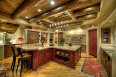 I just love this kitchen, the woodwork, the curves and the colors just great.
