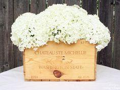 Turn an old wine crate into a blossoming centerpiece, with the help of hydrangeas and a collection of glass jars.
