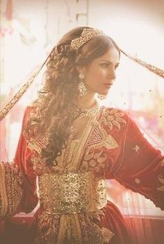 Beautiful Moroccan bride in red and gold caftan