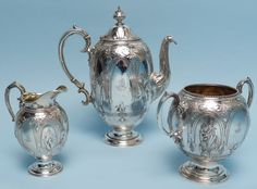19th Century English Three-piece Sterling Silver Coffee Set: coffee pot, open sugar bowl and creamer.