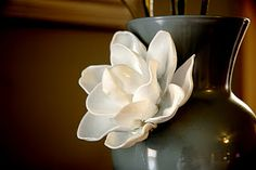 Want to make this flower? It's just plastic melted spoons! Elegant!