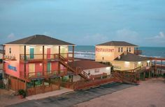 Surfside Beach Tx View Of Ocean Village Hotel And Pirate S Alley Cafe