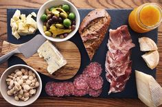 the perfect cheese platter w/ sharp white cheddar, crumbly blue cheese, triple cream/brie, firm manchego, kumquat jam/quince paste, prosciutto, sweet salami, marcona almonds  marinated olives (lucques, nicoise  castelvetrano)