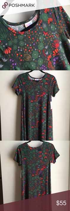 NWT LuLaRoe Whimsical Mod Forrest Floral Carly XS Such a fun print! NWT LuLaRoe Whimsical Mod Forrest Floral Carly in size XS Tons of fun and mod flowers and plant life cover this Carly Amazing jewel-toned colors - red, purple, emerald green & more Deep forrest green background I love the whimsical yet modern feel of this Carly Size XS, but Carly's run large Super-soft and lightweight fabric perfect for warmer months Can also be topped with a sweater or jacket in cooler months Made in China…