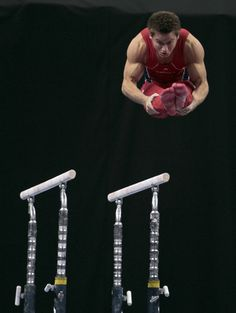 Sam Mikulak dismounts the parallel bars during the men's senior division at the U.S. gymnastics championships on June 7, 2012, in St. Louis. (Jeff Roberson, AP)