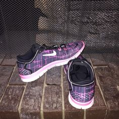 Nike Free Run 5.0 Pink and Black. They are in perfect condition. Like brand new. Can fit an 8 too. Nike Shoes Athletic Shoes