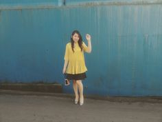 Beauty and the beast vibes. Yellow wearing. Black skirt with yellow blouse mix with silver heels.