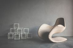 The Betula Chair is a parametric design project by Apical Reform, has a sinuous structure constructed entirely out of birch plywood.