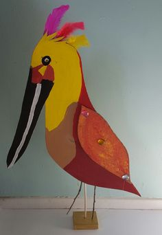 I was inspired by this post from Krokotak  and  this from the Crafty Crow . Birds and recycled cardboard...
