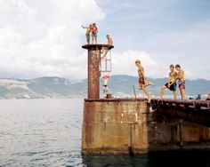 Young men jump into the Black Sea near the harbor in Novorossiysk, Russia. In 1942, the town was occupied by Germans, but a small unit of Soviet sailors defended one part of the town, known as Malaya Zemlya, for 225 days. Novorossiysk was awarded the title 'Hero City' in 1973.