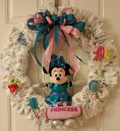 My second diaper wreath. Baby Shower theme was Minnie Mouse.