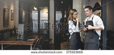 Barista Coffee Shop Waiter Waitress Couple Apron Concept - stock photo