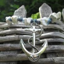 """This necklace is just what you need to make your outfit perfectly summer. It features an anchor charm on a mix of howlite (white), sodalite (blue with white speckles) and blue stone chip beads. It is approx. 20"""" long before the pendant."""