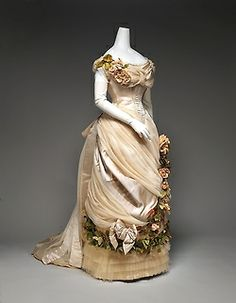 House of Worth | c. 1882 This dress is in the Impressionism, Fashion and Modernity exhibition currently at The Metropolitan Museum of Art. It is stunning in person. The train has wide pleats of satin and tulle that fan out perfectly. I could not look away. I just wanted to keep staring but some 55 year old mother and herprecocious,test tube, 5 year old daughter cock blocked me and pressed their faces against the glass.