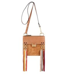 Chloé - Jane leather and suede shoulder bag - Chloé's 'Jane' shoulder bag has marched straight off the Spring '16 runway and onto our wish lists. The compact design is playful in attitude and features multicoloured tassels and golden rings for bohemian spirit. Super slimline, it's the perfect choice for days when weightless, effortless style is essential. Carry yours by the long leather shoulder strap or detach and use as a handy clutch. seen @ www.mytheresa.com
