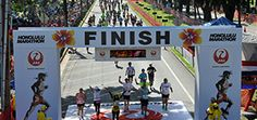 DEC: Honolulu Marathon. Inexpensive, walker friendly, Hawaii. I mean come ON. :D