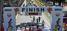 DEC: Honolulu Marathon. Inexpensive, walker friendly, Hawaii. I mean come ON. :D