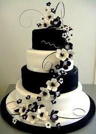 Black and white cakes are the way to go.  I love that the black and white are on different tiers and the flowers bring it all together.