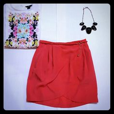 Tulip skirt with pockets . More watermelon pink than red. The photo show more red. Seems a little small for an 8. Skirts