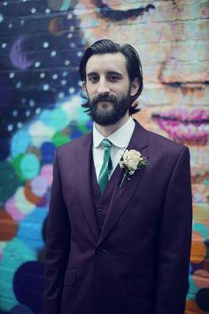Dapper purple groom's suit.