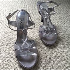Touch of Nina Silver Heels Beautiful heels about 3-31/2 inches tall. These were worn once for prom. Feel free to make an offer or ask questions Touch of Nina Shoes Heels
