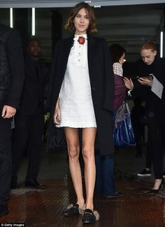Showcasing her legs by donning a white button-up dress for the occasion, the 31-year-old f...