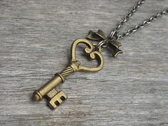 Victorian Gothic Steampunk Skeleton Key & Bow Necklace by InkandRoses13- like this key shape