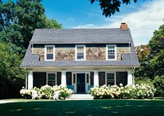Dutch Colonial via Cottage Living August Home exterior, gray shingles, front porch, hydrangeas and Adirondack Chairs. Mansard Roof, House, Cottage, Enchanted Home, Curb Appeal, Attic Remodel, Shingle House, Dutch Colonial, House Exterior