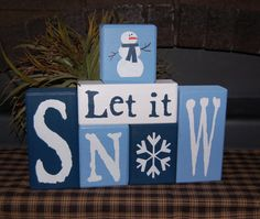 Let It SNOW Snowman Wood Sign Shelf Blocks Primitive Country Rustic Holiday Seasonal Home Decor. $34.95, via Etsy.