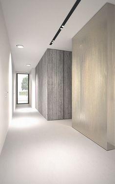 Brass vs concrete hallway --