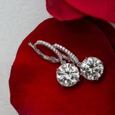 Our Diamond drop earrings are a classic that will take you from day to night. Shop these round brilliant classics in our Atlanta, Ga showroom. #UniversalDiamonds