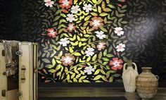 """Elitis Perles Nouvel Eden is a large scale panoramic wallcovering details a floral print on a moody backdrop. Embossed textured vinyl wallpaper with a beaded feel.   Sold by 4 panels of 27"""" width X 118"""" height roll"""