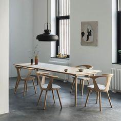 The dinning room. In Between Table & Chairs, in white oiled oak by Sami Kallio. True coloures vases by Lex Pott. Copenhagen Pendant in matt black by Space Copenhagen.