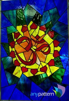 Aum symbol colorful stained glass pattern, intermediate skill level