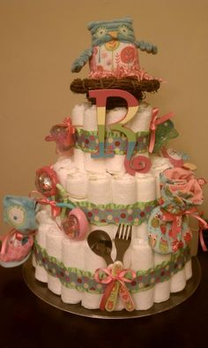 Owl Diaper Cake from Merdy's Diaper Cakes made to match Pottery Barn Owl bedding.