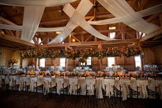 Great overhead floral centerpiece!  You could use a candle lighiting platform for a smaller version of this. Custom Ceiling Treatment & Floral Installation by Blue Bouquet, via Flickr
