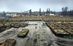 Russian tanks abandoned after the fall of the  Soviet Union.