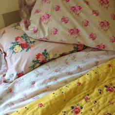 Cozy beds with vintage linens