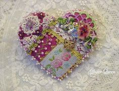 Crazy quilt pin with Victorian charm.  2.5 in.